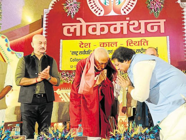 Samdhong Rinpoche (centre) is welcomed by state culture minister Surendra Patwa and Anupam Kher in Bhopal on Monday.
