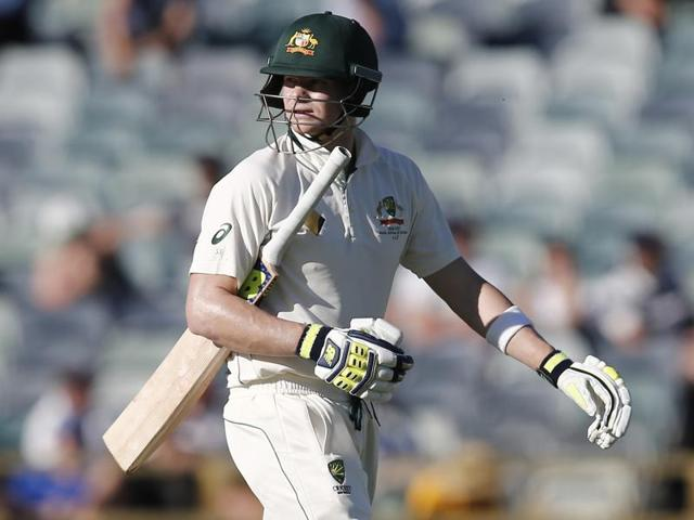 Australia's Steve Smith looks at a replay as he walks from the ground after being dismissed on day four.