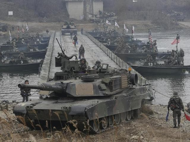 US tanks cross the Hantan river during a river crossing operation, part of an annual joint military exercise with South Korea against a possible attack from North Korea, in Yeoncheon.