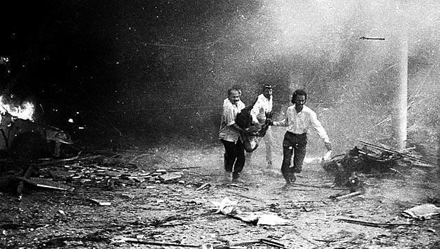 File photo of people rushing a victim to the hospital from Air India building after the bomb blast in 1993.