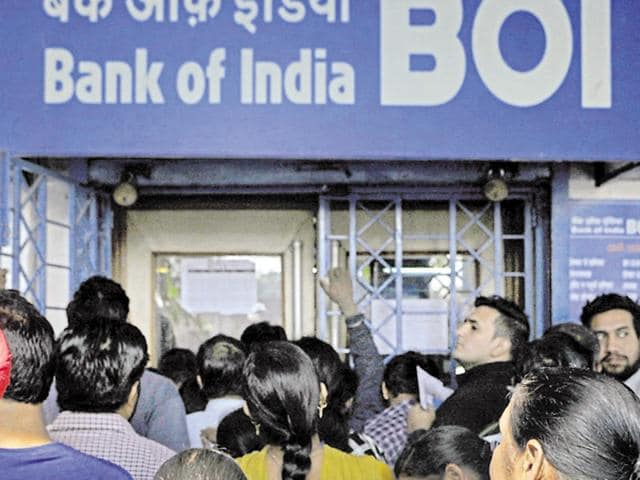 People waiting for a bank branch to open at Bank Square, Sector 17, in Chandigarh on Tuesday.