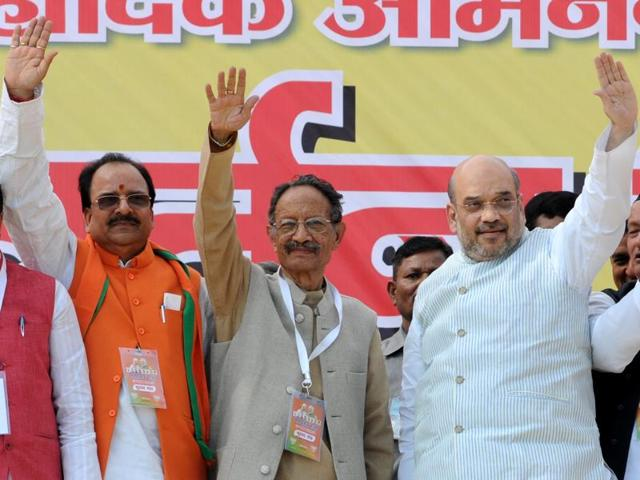 BJP chief  Amit Shah (R) with state unit  president Ajay Bhatt (L) during the launch of Parivartan Yatra in Dehradun,