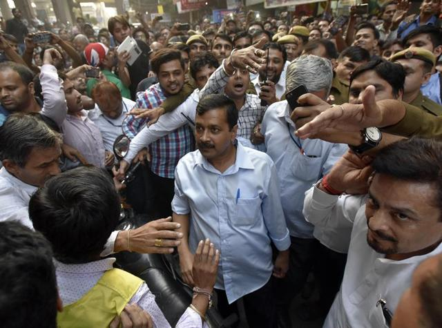Delhi chief minister Arvind Kejriwal meeting shopkeepers to talk about demonetisation at Laxmi Nagar market on November 12.