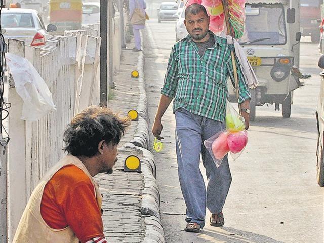 A beggar at the Bharat Nagar Chowk traffic lightpoint on Ferozepur Road in Ludhiana on Tuesday.