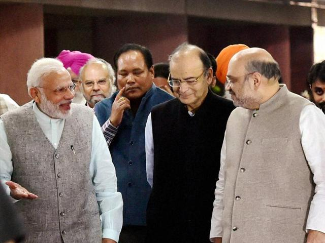 Prime Minister Narendra Modi, BJP President Amit Shah and Union Ministers, M Venkaiah Naidu, Ananth Kumar and Ram Vilas Paswan leave after NDA meeting at Parliament house in New Delhi on Monday
