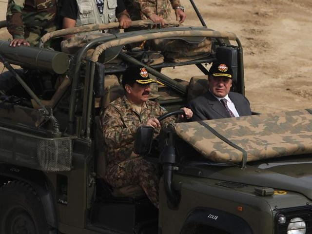 Pakistan army chief Gen. Raheel Sharif, left, drives by Prime Minister Nawaz Sharif during a military exercise in Khairpur Tamiwali, Pakistan, on Wednesday.