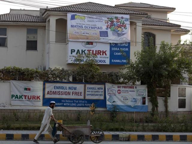 A Pakistani guard stands outside the Rawalpindi campus of Pak-Turk school in Pakistan, on November 16, 2016. Pakistan has ordered 400 Turk nationals associated with the Pak-Turk International chain of schools and colleges to leave the country in the next 72 hours.