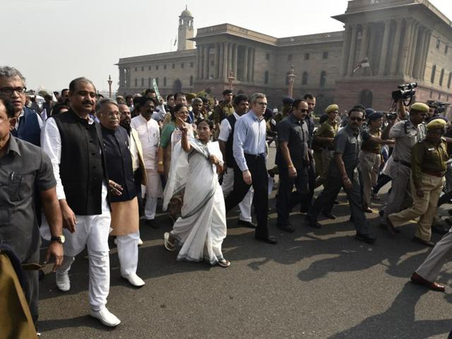 West Bengal CM Mamata Banerjee, along with the other opposition leaders, march from Parliament to Rashtrapati Bhavan against the government's demonetisation move, on Wednesday.