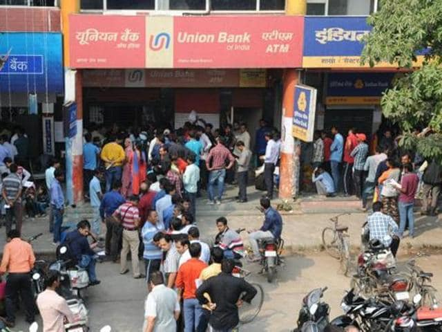 People have to remain stand in the long queues for hours in banks and atms to get their cash.