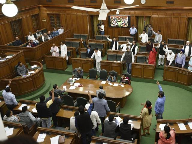 AAP MLAs shout slogans against Prime Minister Narendra Modi during the special session of Vidhan Sabha on black money in New Delhi on Tuesday.