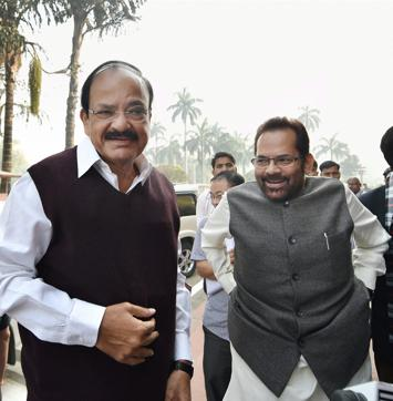 Union information and broadcasting minister M Venkaiah Naidu and MoS Mukhtar Abbas Naqvi at Parliament on the opening day of the winter session, in New Delhi.