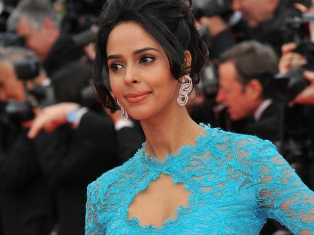 Mallika Sherawat arrived at the Paris apartment with a male friend.