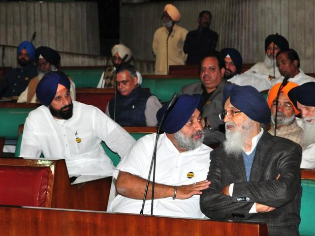 Deputy CM Sukhbir Badal talks to CM Parkash Singh Badal as revenue minister Bikram Singh Majithia (left) and others also seen during the special session at the Punjab Vidhan Sabha in Chandigarh on Wednesday, November 16.