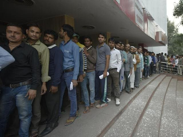 People stand in a long queue at Dak Bhawan, Parliament Street in New Delhi.