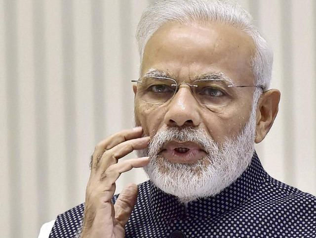 Prime Minister Narendra Modi gestures as he delivers a speech in New Delhi.