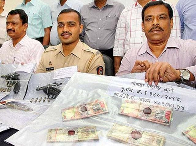 Cash worth nearly Rs 73 lakh in now defunct denominations of Rs 1,000 and Rs 500 was seized from two cars.