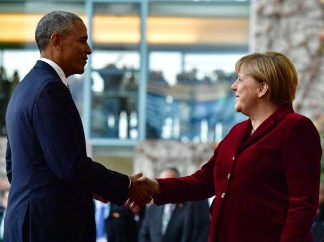 US President Barack Obama shakes hands with German Chancellor Angela Merkel upon arrival at the chancellery in Berlin.