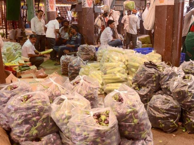 Traders wait for customers at APMC market in Navi Mumbai on Monday.