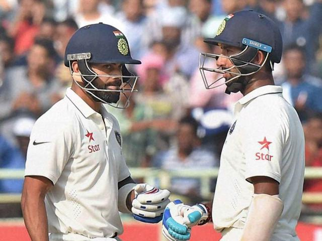 Indian captain Virat Kohli and batsman Cheteshwar Pujara during the first day of the 2nd Test cricket match.