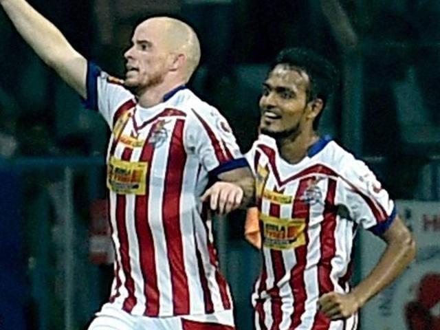 Atletico de Kolkata player Iain Edward Hume (R) plays during Indian Super League football match.