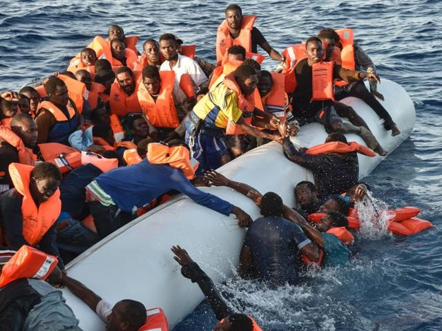 Migrants panic as they fall in the water during a rescue operation in the Mediterranean Sea. A migration organisation says that about 340 migrants have died or gone missing in four Mediterranean Sea shipwrecks over the past two-and-a-half days.