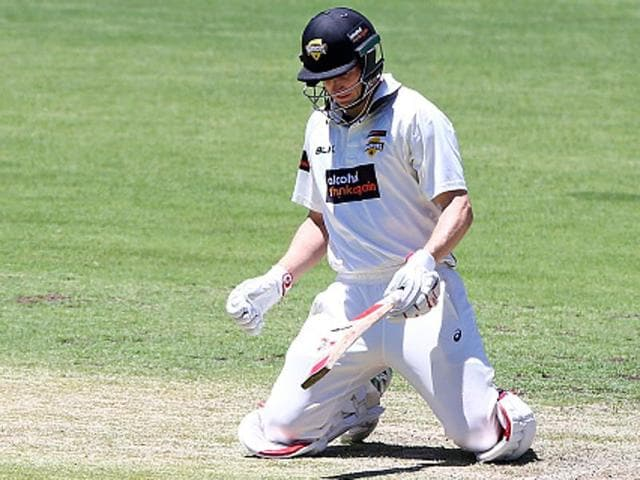 Adam Voges of the Warriors sinks to his knees after being struck in the head by a bouncer from Cameron Stevenson.