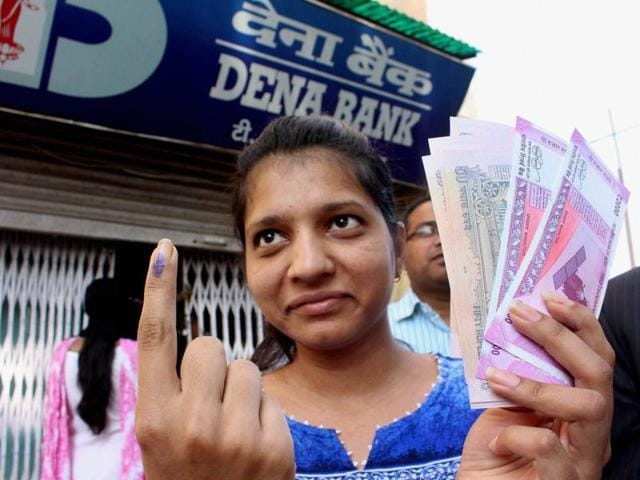 Farmers and villagers wait outside the Neelbad branch of SBI near Bhopal on Wednesday.