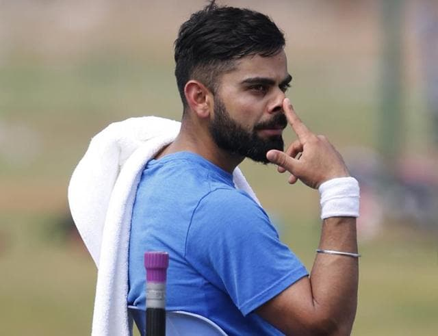 Virat Kohli curbed his natural instinct in Rajkot to force a draw against England.
