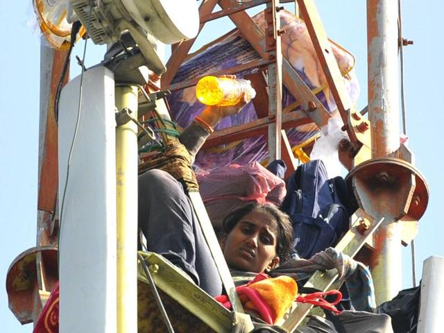 Protestors climb mobile tower demanding jobs from Punjab Government in Sector 3,Chandigarh on Thursday.