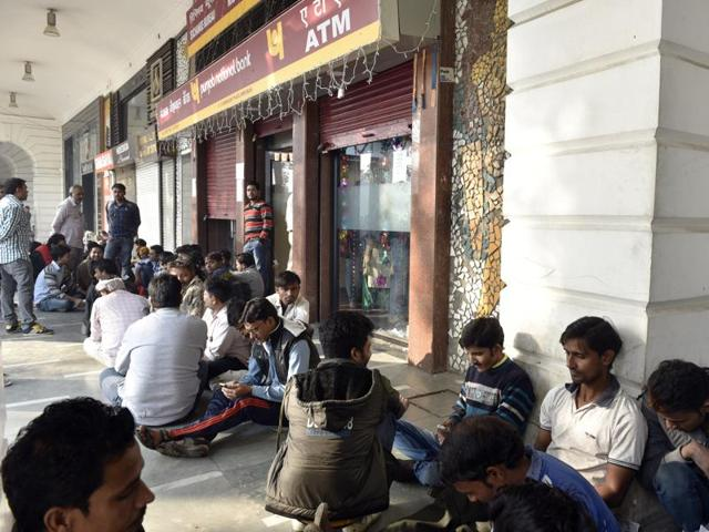 Long queues outside banks at Connaught Place in New Delhi on Friday.
