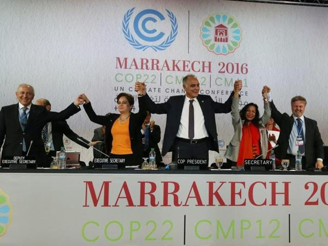 UN climate chief Patricia Espinosa, second from left, Morocco's foreign minister Salaheddine Mezouar, centre, and Council of Europe goodwill ambassador Bianca Jagger, seconf from right, celebrate after the proclamation of Marrakech.