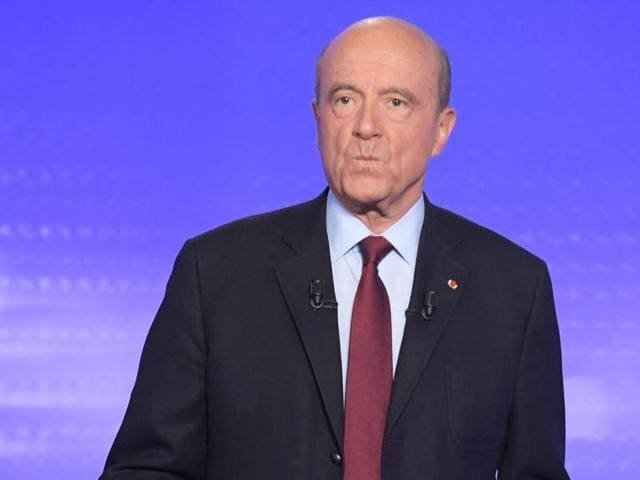 French politician Alain Juppe attends the third prime-time televised debate for the French center-right presidential primary in Paris on Thursday.