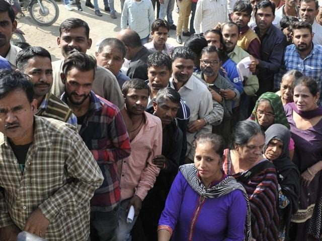 People waiting for their turn outside the bank in Ludhiana on Thursday.
