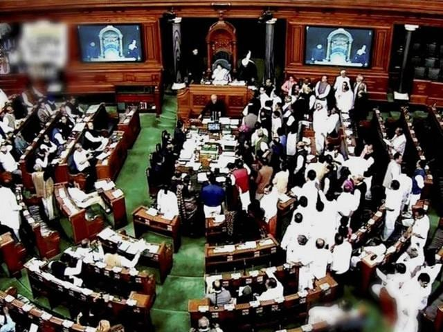 Opposition members protest in the well of Lok Sabha during the winter session of Parliament in New Delhi on Friday.