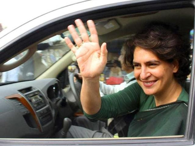 Priyanka Gandhi Vadra waves to supporters of the Congress party after her address at an election campaign rally in Amethi.