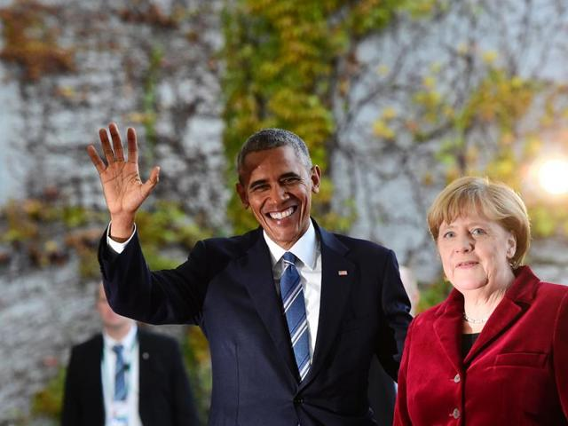 US President Barack Obama is greeted by German Chancellor Angela Merkel upon arrival at the chancellery on November 17 in Berlin.