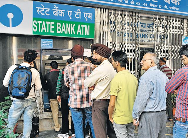 People queuing up in front of an SBI ATM at Sector 17 in Chandigarh on Friday.