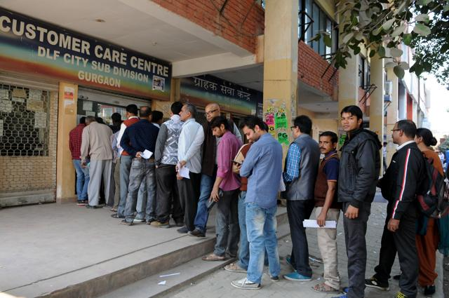 Consumers queue up to pay their bills at the costumer care centre in Sector 31 on Friday.