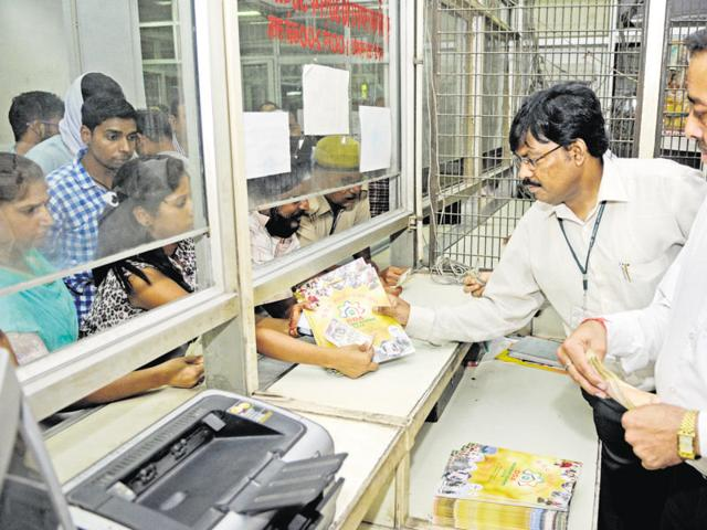 File photo of people buying DDA housing scheme forms. This year, the DDA has offered 13,000 flats under the new scheme that was finalised on Friday.