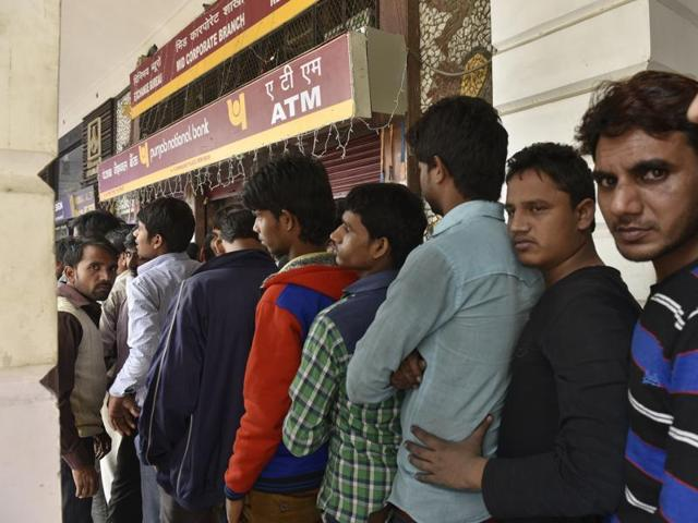 Long queues outside a bank at Connaught Place in New Delhi on Friday.