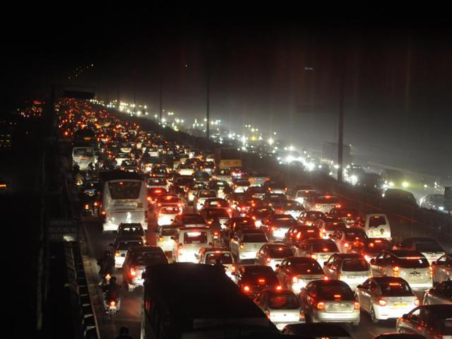Jam on Delhi-Gurgaon expressway between Iffco Chowk and Sirhaul toll plaza as commercial vehicles halt to load passengers near exit 18.