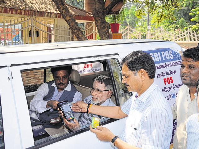 State Bank of India's mobile ATM van allows a customer to withdraw cash in Bhopal on Friday.