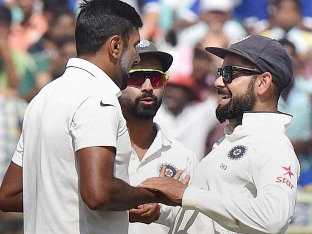 Indian captain Virat Kohli celebrates after Ravichandran Ashwin scalped an England batsman on Saturday. Ashwin took the 22nd five-wicket haul of his career in Visakhapatnam.