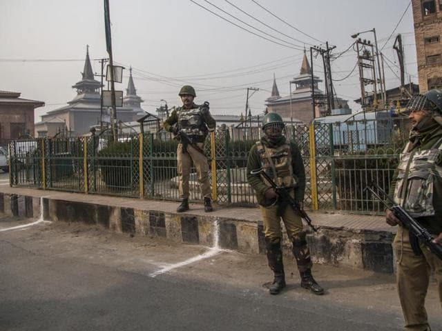 Paramilitary soldiers stand guard outside the Grand Mosque during a strike in Srinagar.