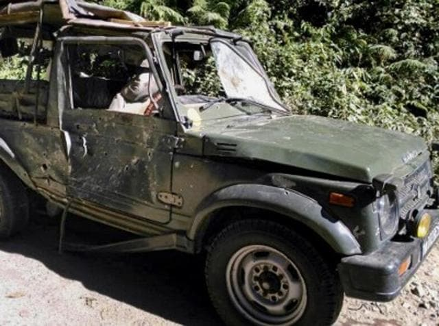 Bullet marks are seen on a damaged army vehicle at Pengeri in Assam's Tinsukia district on November 19, 2016, following an ambush attack by armed militants.