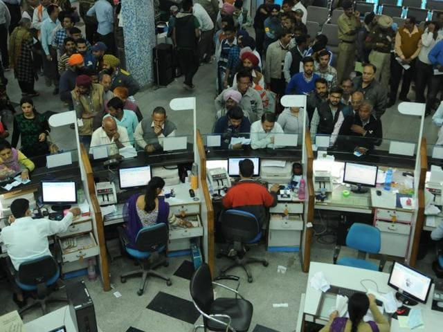 Rush for currency exchange at the main branch of State Bank of India in Jalandhar on Friday.