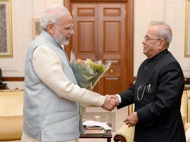 President Pranab Mukherjee with Prime Minister Narendra Modi at Rashtrapati Bhavan in New Delhi.