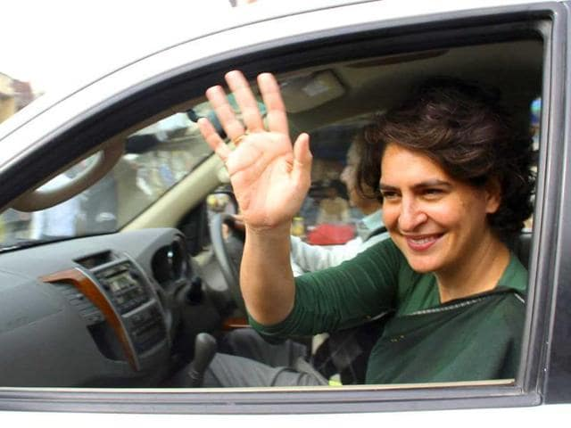 Priyanka Gandhi Vadra waves to supporters of the Congress party after her address at an election campaign rally at Amethi.