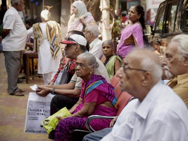 Senior citizens queue up outside a bank to exchange their old Rs 500 and 1000 notes outside in Mumbai.