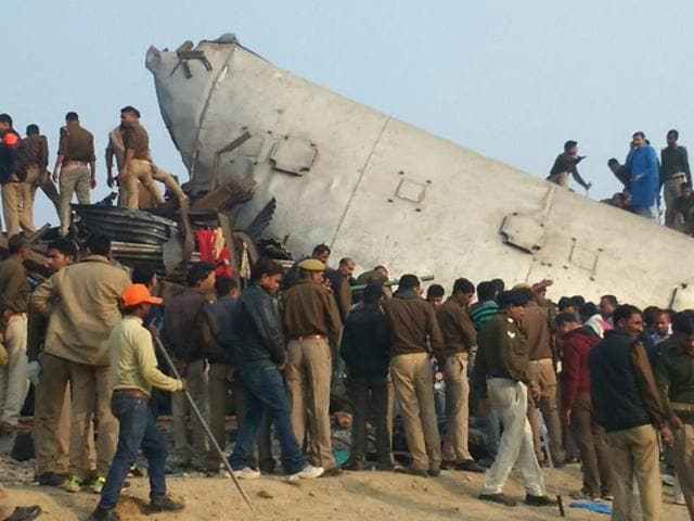 Police and locals during rescue operations at the site of accident in Pukhrayan near Kanpur.